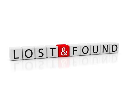 Lost and Found - White dice containing the text lost and found. Isolated from a white background. Stock Photo