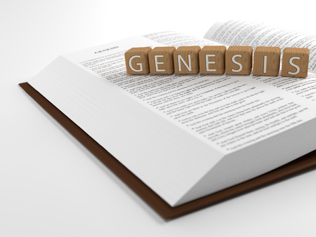 Genesis and the Bible - The word genesis layed on top of the Bible. Stock Photo - 41781236