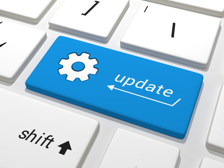 business software: Software Update - A blue key on a white keyboard containing the text update.