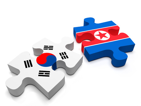 korea map: North Korea - South Korea -  2 jigsaw puzzle pieces, 1 containing the flag of North Korea, the other of South Korea. Isolated on a white background.