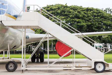 Airplane  with passenger stairs photo