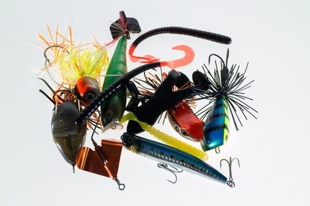 different fishing baits  on white background photo