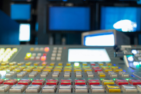 mixing: Wide shot of vision mixing panel in a television gallery.