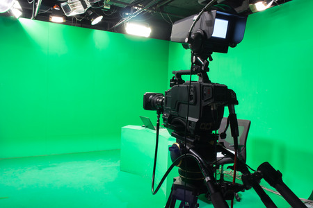 tv sets: Television studio with camera and lights - camera on tripod: Shallow depth of field