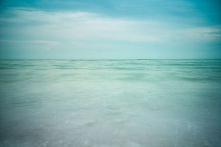 green sea: Long exposure shot blue sky and green sea empty.image vignett