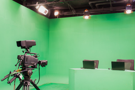 television set: Television studio with camera and lights - camera on tripod Stock Photo