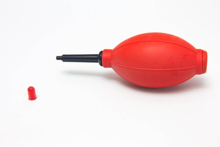 blowpipe: red air blower pump for dust cleaner in Camera Stock Photo