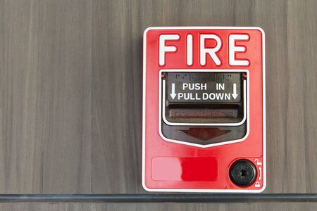 push button: Push button switch fire and telephone on wood background Stock Photo