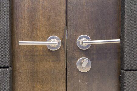 door handle: Door handles installed at the entrance to the studio.