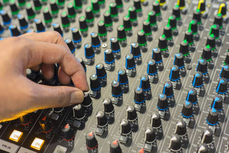 fader: Hand was captured buttons equipment for sound mixer control