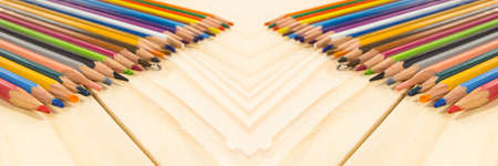 Panorama colored pencils angleMany different colored pencils on wood background Stock Photo