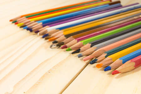 Colored pencils angleMany different colored pencils on wood background