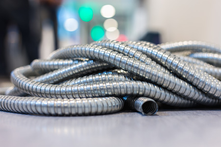 Flexible metal pipe on construction site. Stock Photo