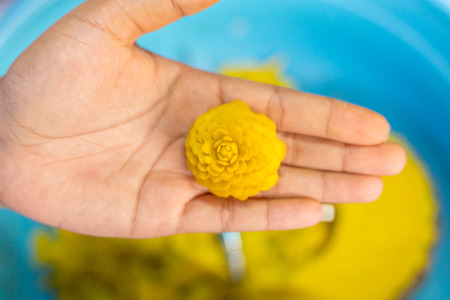 woman's hand: Womans hand carved pumpkin flowers.