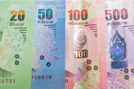 Pictures of Thai banknotes of different value.