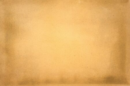 Aged texture of old vintage brown paper, can be use as abstract background, wallpaper,  webpage, copy space for text.
