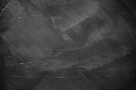 Texture of chalk rubbed out on blackboard or chalkboard background. School education, dark wall backdrop or learning concept.