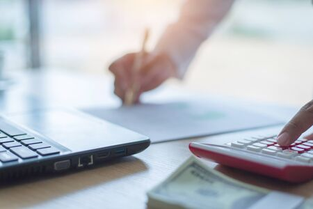 Money accountants are calculating income and analyzing marketing plans.