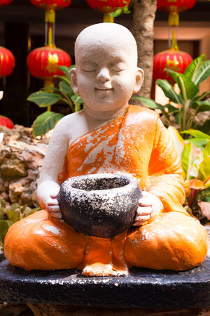 novice: Statue of serenity novice Buddhist in the garden