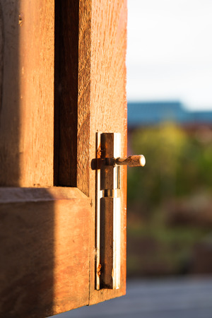 close up old wooden window with Antique Iron window Latch photo