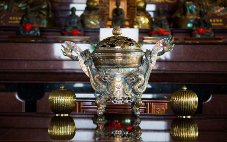A traditional asian incense burner with a dragon  photo