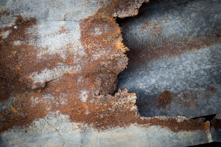 rust: Tear of old tin and rust background