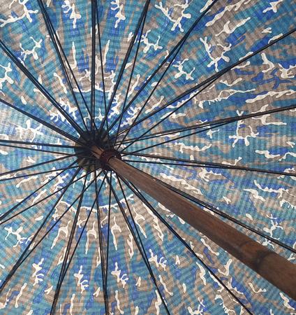 sunlight behind the umbrella Stock Photo