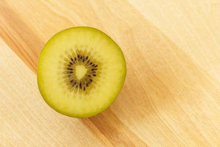 kiwi fruit on wooden cutting board