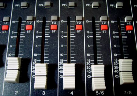 decibel: the faders and buttons of an audio mixer