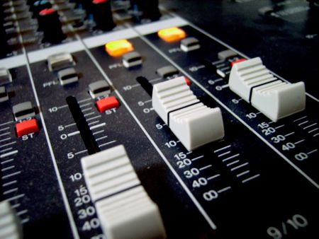 the faders and buttons of an audio mixer