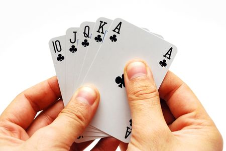 A hand holding five cards in a game of poker isolated Stock Photo