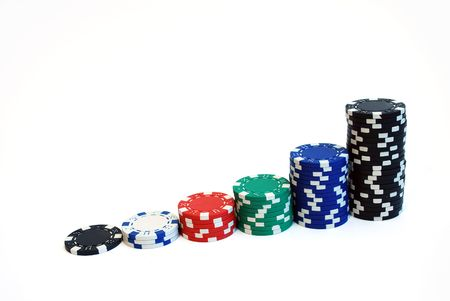 isolated close up of casino chips on white background
