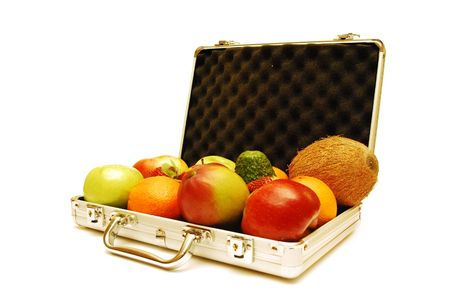 Different fruits in metal suitcase for money isolated on white. photo