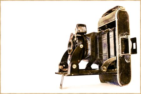 stock photography: vintage old style photo camera isolated on white background