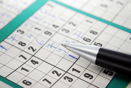 A partially filled sudoku puzzle with pencil Sudoku photo
