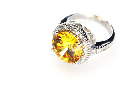 Ring with orange stone isolated on the white