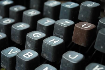 detail of a black vintage typewriter close up on keys photo