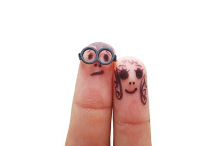 look at: Fingers with eyes representing funny figures isolated on white