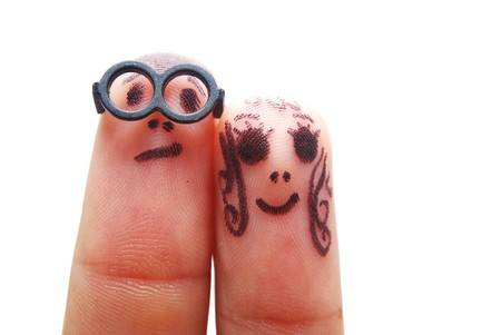 humoristic: Fingers with eyes representing funny figures isolated on white