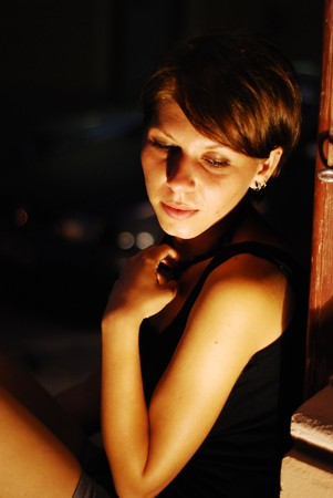 Young pretty girl in front of an yellow spotlight posing Stock Photo - 7561431