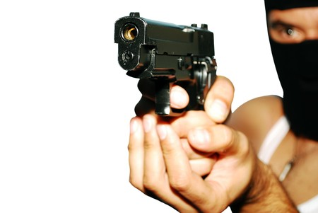 Young man holding up a gun with the focus on his gun isolated. Banco de Imagens