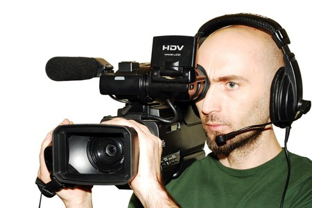 image with a television cameraman working with camera isolated photo