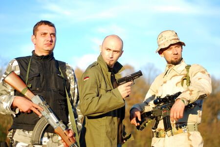 guerilla: three kind of soldiers posing military movie poster like Stock Photo