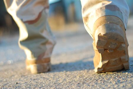 close up of soldier boots walking seen from behind