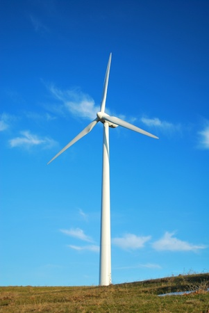eolian: Windmill in Romania gathers energy from the summer breeze.