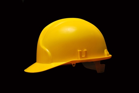 safety helmet: Image of a yellow helmet isolated on black background