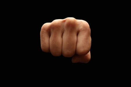 male boxer: A man�s fist isolated on black background