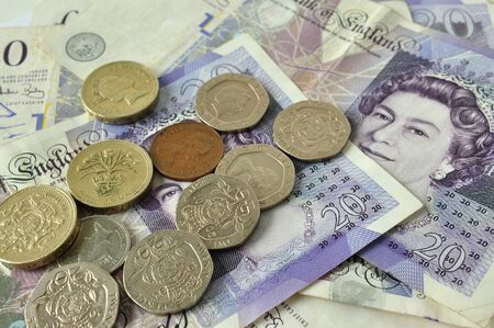 British currency coins and notes mixed together