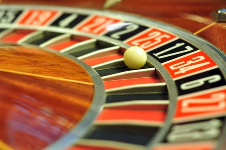 image with a casino roulette wheel with the ball on number 17 photo