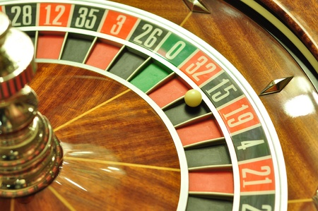 image with a casino roulette wheel with the ball on number 15